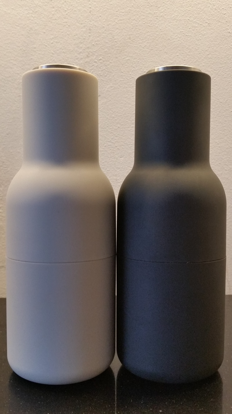white and ash coloured small bottle grinder