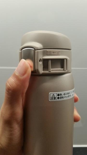 opening button zojirushi travel mug